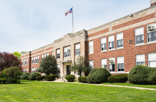 Exterior view of a typical American school building seen on a spring day