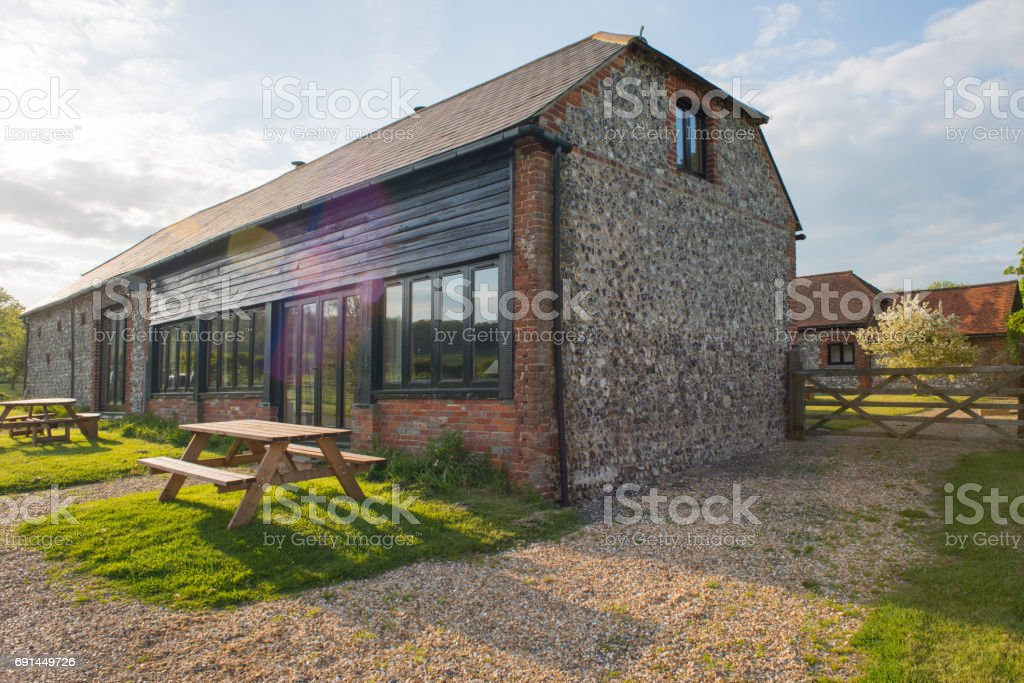 Exterior View of Brick Barn House and Landscaping stock photo