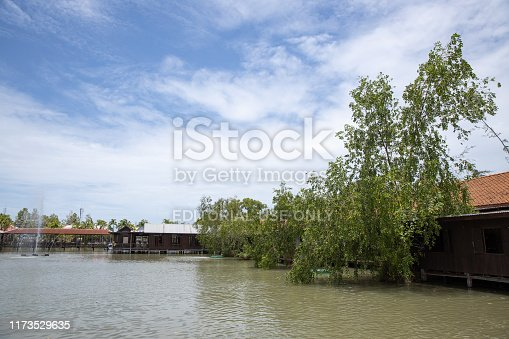 Rayong, Thailand - July 28, 2019 : exterior view of floating Ko Kloi old market ,the traditional famous shopping area with blue sky and cloud.