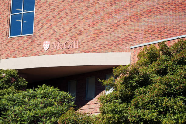 Exterior view of Mc Gill university brick building and the logo in Montreal, Quebec, Canada stock photo