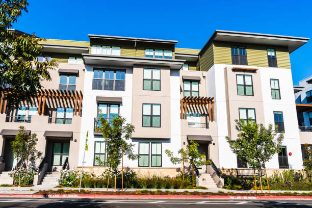 Exterior view of multifamily residential building; Mountain View, San Francisco bay area, California Exterior view of multifamily residential building; Mountain View, San Francisco bay area, California housing development stock pictures, royalty-free photos & images