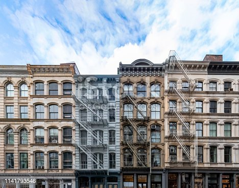 istock Exterior view of old apartment buildings in the SoHo neighborhood of Manhattan in New York City 1141793546