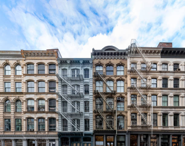 exterior view of old apartment buildings in the soho neighborhood of manhattan in new york city - new york foto e immagini stock