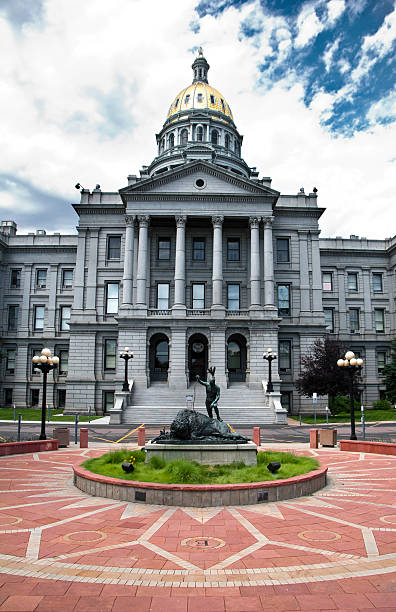 exterior view of statue and state capitol in denver colorado - colorado state capitol stock photos and pictures