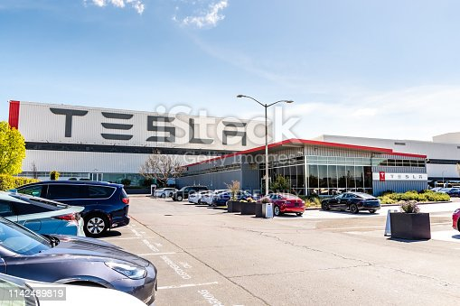 April 12, 2019 Fremont / CA / USA - Exterior view of Tesla Factory located in East San Francisco bay area, California; Tesla logo displayed on the exterior wall
