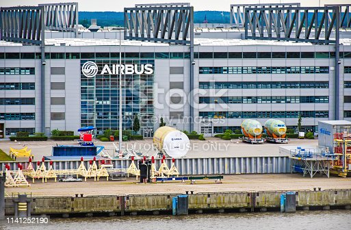 Hamburg, Germany - August 4, 2018: Exterior view of the Airbus factory in Hamburg-Finkenwerder. Aircraft parts are stored in front of the building.