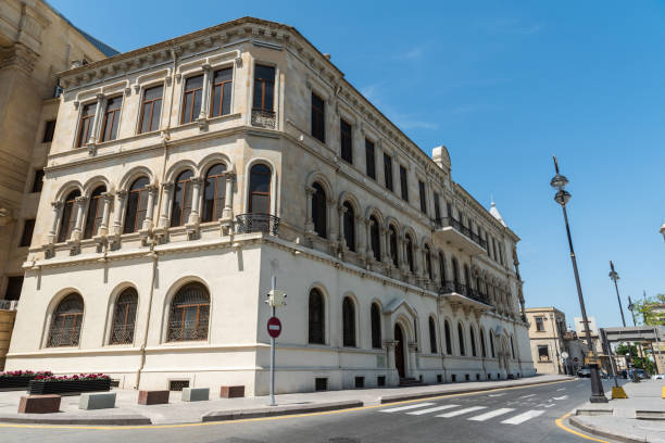Exterior view of the building housing the General Prosecutor Administration of the Republic of Azerbaijan and the Museum of General Prosecutor Administration in Baku. Baku, Azerbaijan - May 9, 2019. Exterior view of the building housing the General Prosecutor Administration of the Republic of Azerbaijan and the Museum of General Prosecutor Administration in Baku. adversarial stock pictures, royalty-free photos & images