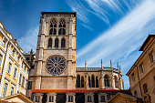 Majestic ancient architecture of Saint-Jean-Baptiste Cathedral monument in Lyon old town, in Vieux Lyon district. Photo taken in Lyon famous city, Unesco World Heritage Site, in Rhone department, Auvergne-Rhone-Alpes region in France, Europe during a sunny summer day.