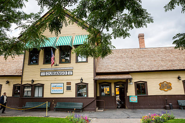 Exterior views of the historic train station in Durango Durango, USA - August 27, 2015: Exterior views of the historic train station in Durango and its trains on August 27, 2015. The trains drive between Durango and Silverton in the state of Colorado. animas river stock pictures, royalty-free photos & images