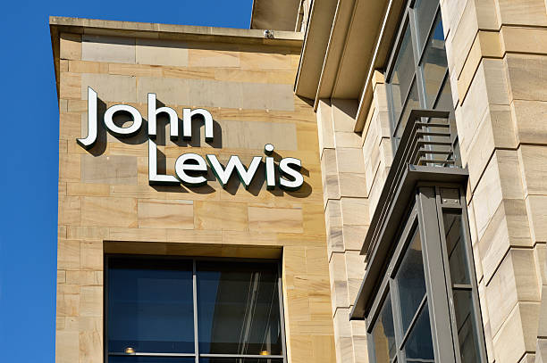 Exterior wall and sign of the John Lewis department store Glasgow, Scotland, UK - August 8, 2012: The sign on the exterior wall of the John Lewis department store at the top end of Buchanan Street, Glasgow. John Lewis is a chain of shops found in major cities throughout the UK. johnfscott stock pictures, royalty-free photos & images