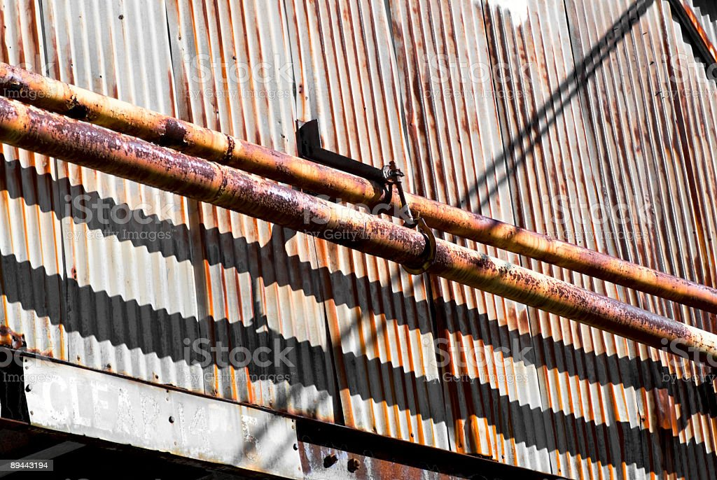 exterior wall of a run down urban metal rusty building royalty-free stock photo