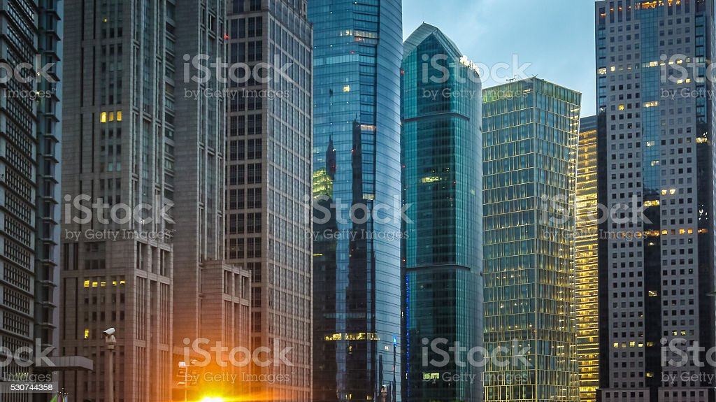Exteriors of modern financial buildings at dusk stock photo