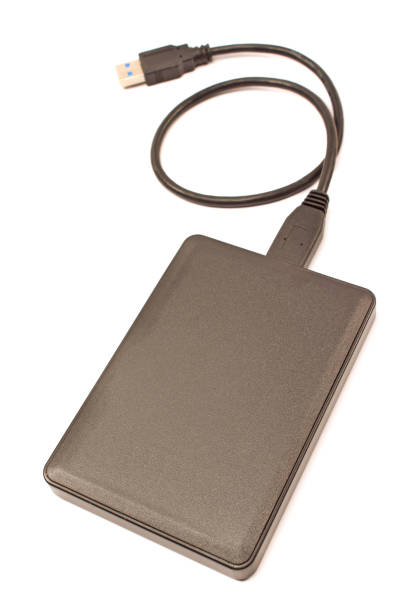external hard disk isolated on white background - external hard disk drive stock photos and pictures