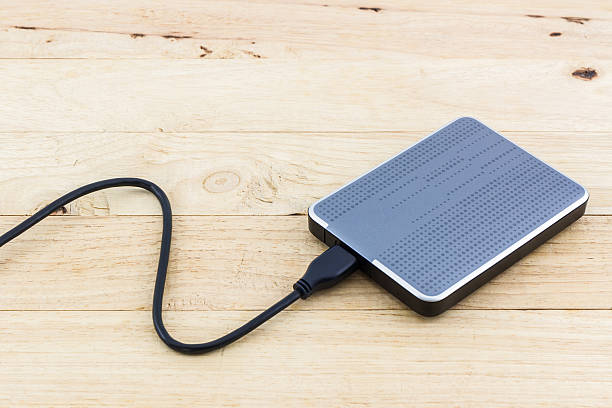 External hard drive for backup. External hard drive for backup on wood background. external hard disk drive stock pictures, royalty-free photos & images