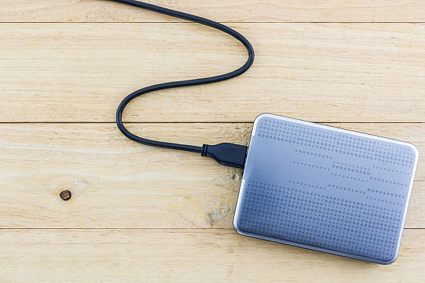 external hard drive for backup. - external hard disk drive stock photos and pictures
