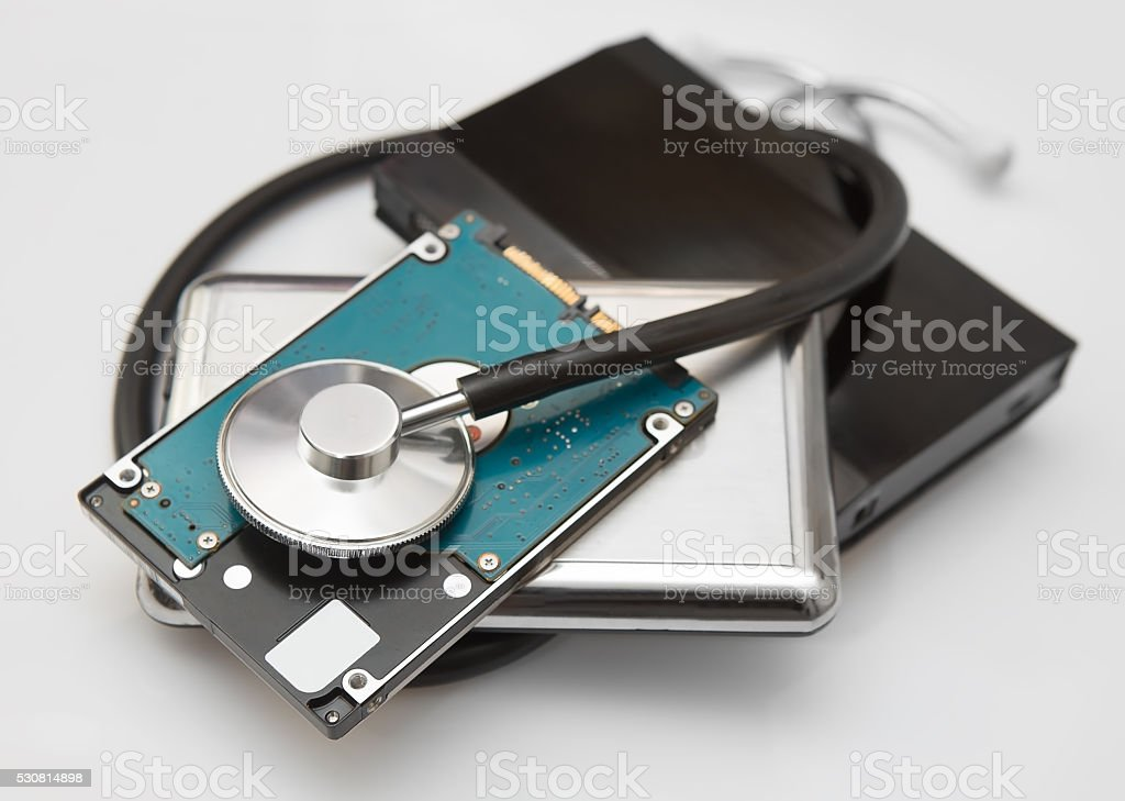external hard drives and stethoscope stock photo