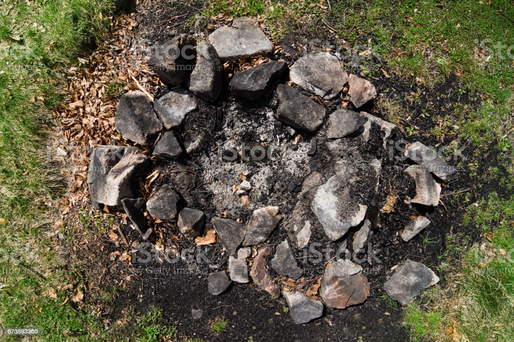 extinguished camp fire place stock photo