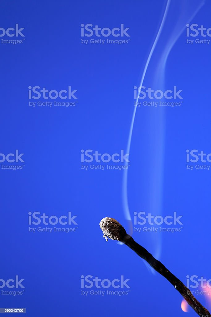 Extinguished Match On Blue royalty-free stock photo
