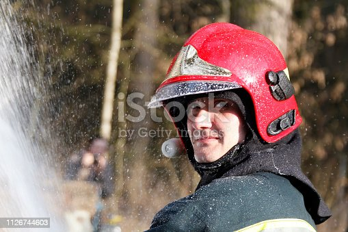 Extinguishing forest fire.Belarus,Fire man.Portrait of a man who works as a fireman