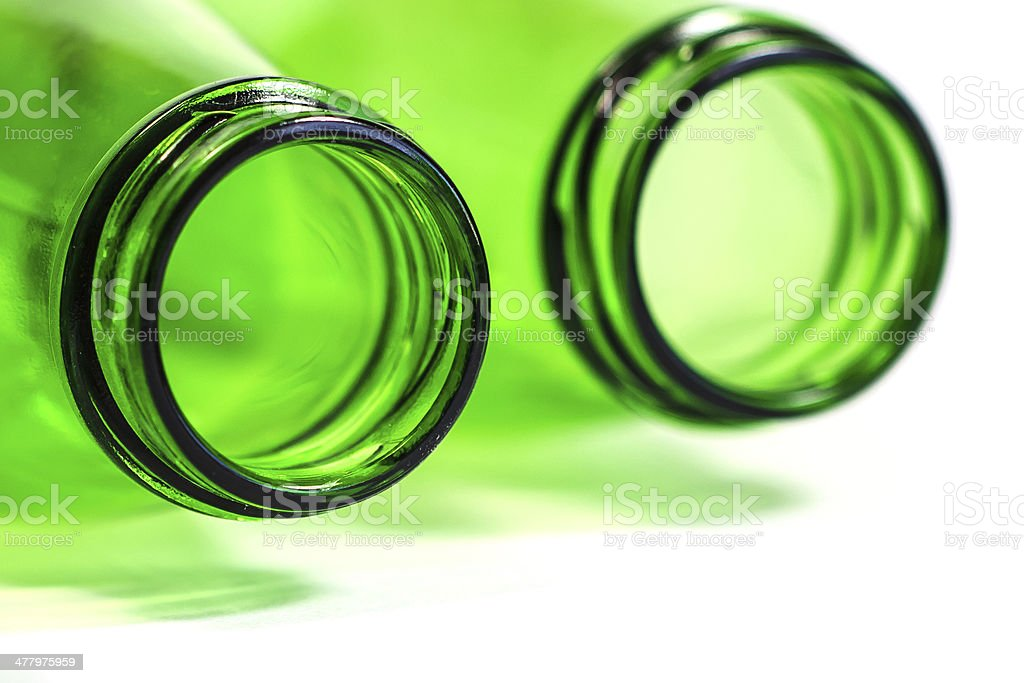 Extra Closeup of Green Bottles Lay Down on White Background royalty-free stock photo