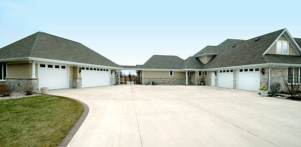 Extra Large Five Stall Garage, Gabled Roof, Concrete Drive Way stock photo