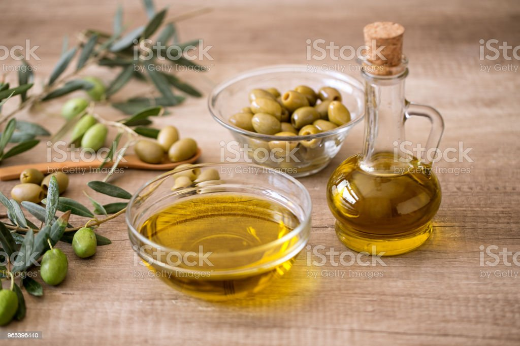 Extra virgin healthy Olive oil with olive on wooden background zbiór zdjęć royalty-free