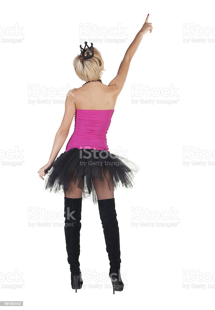 Extravagant blonde in  crown pointing. Rear view royalty-free stock photo