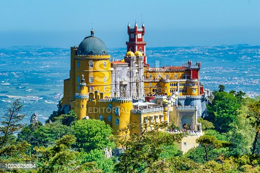 Extravagant Pena Palace in Sintra, Portugal. Photo taken from a nearby lookout during a warm summer day.