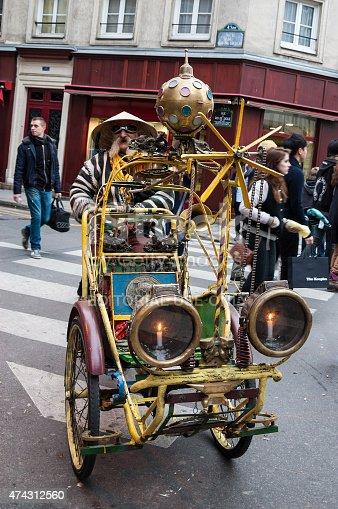 istock Extravagant senior rickshaw drives his unique vehicle in Paris, France. 474312560