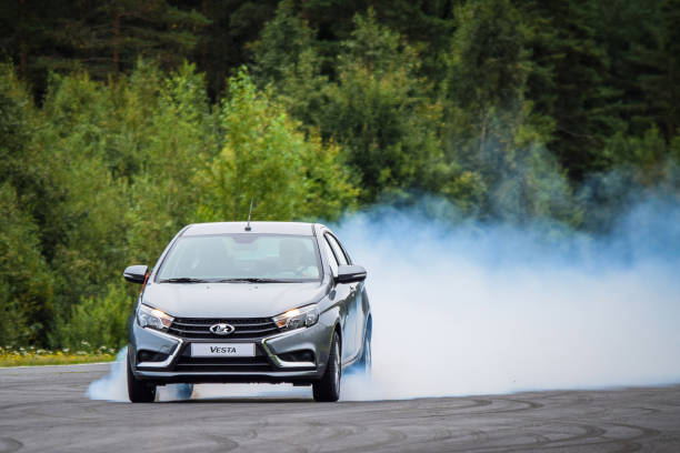 Extreme braking with smoke from the tyres. stock photo
