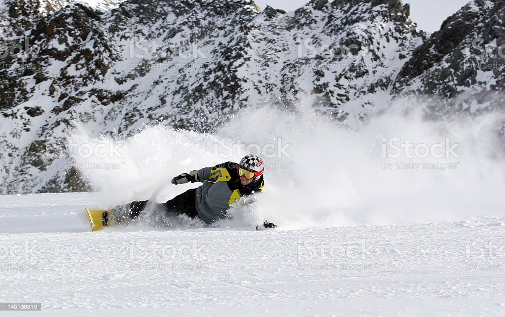 Extreme carving snowboarder stock photo