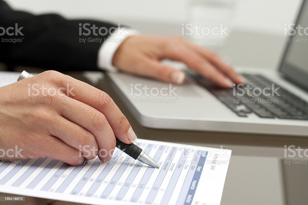 Extreme close up of female hands working. stock photo