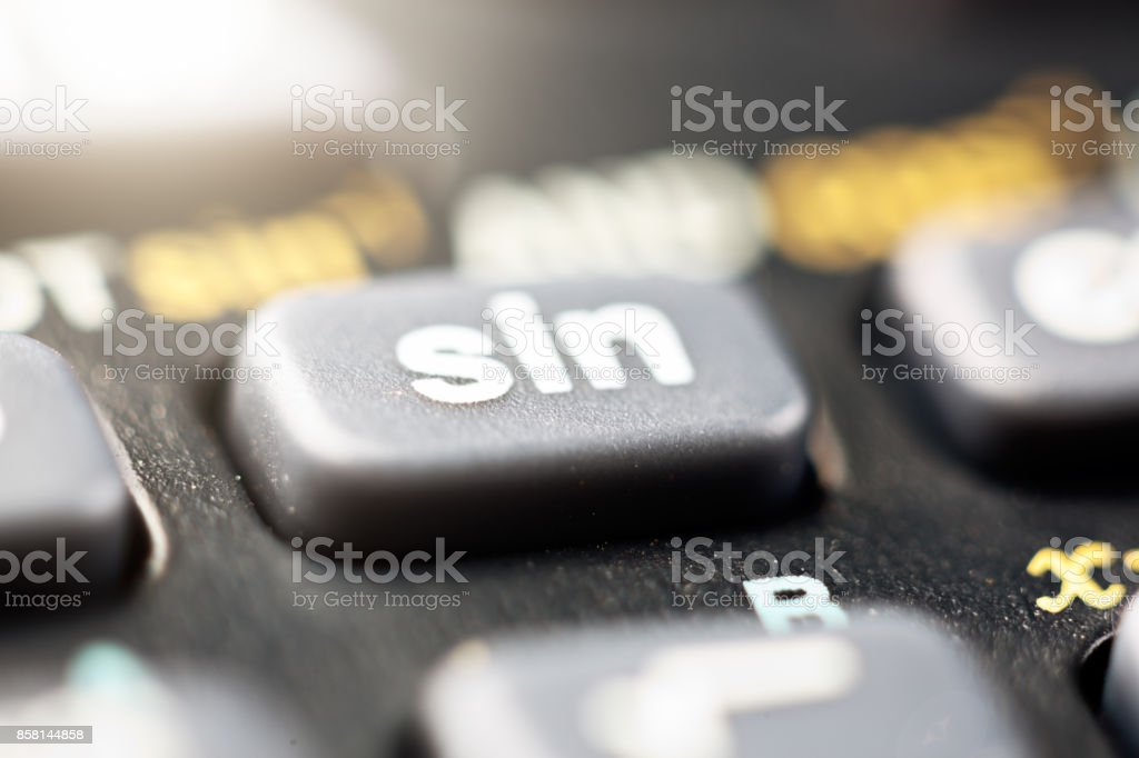 Extreme close up of the sine key on a scientfic calculator stock photo