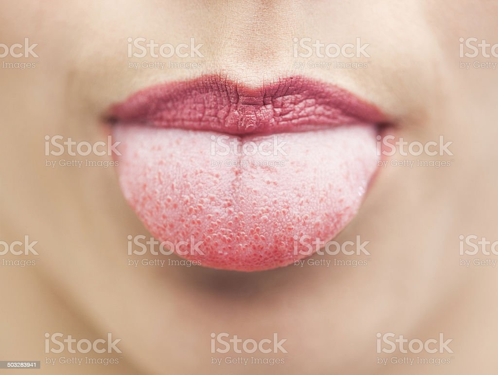 Extreme close up on beautiful mouth tongue out stock photo