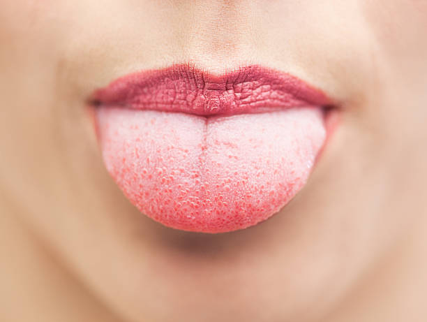 extreme close up on beautiful mouth tongue out - sticking out tongue stock photos and pictures
