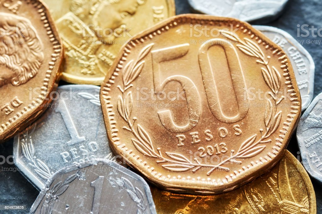 Extreme close up picture of Chilean peso coins. stock photo