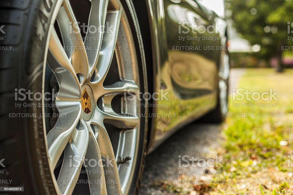 Extreme close up shot wheel with trademark. Porsche Cayman stock photo