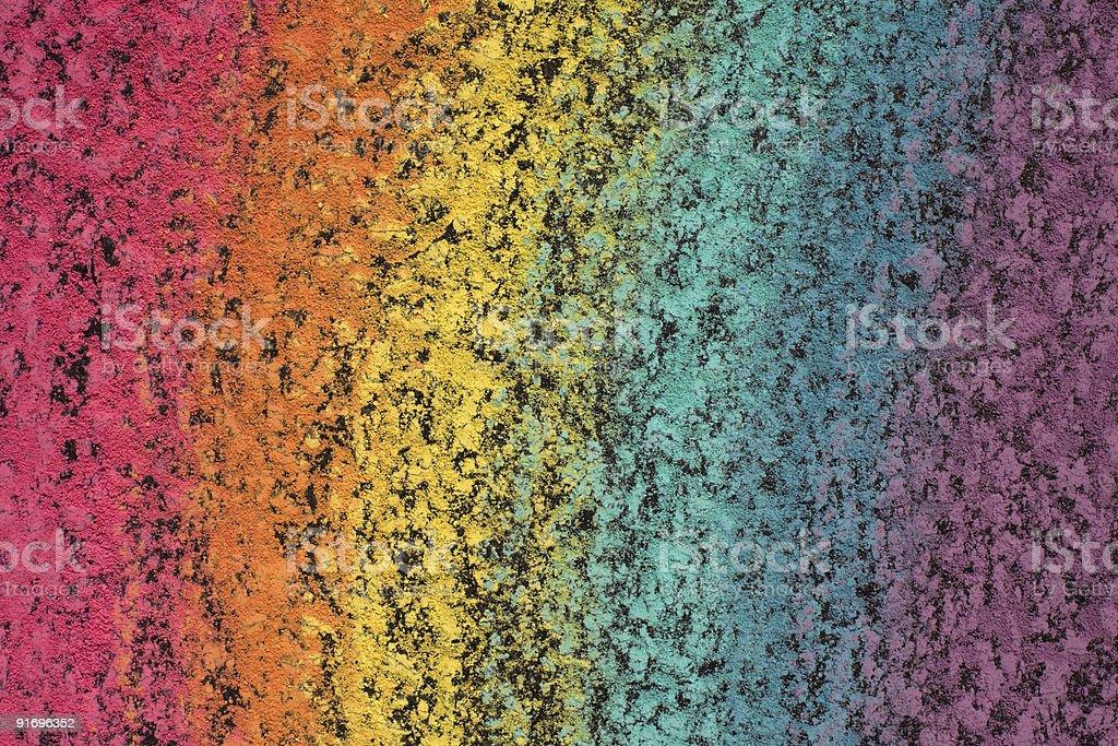Extreme Closeup of Rainbow Chalk Pattern on Asphalt Surface royalty-free stock photo