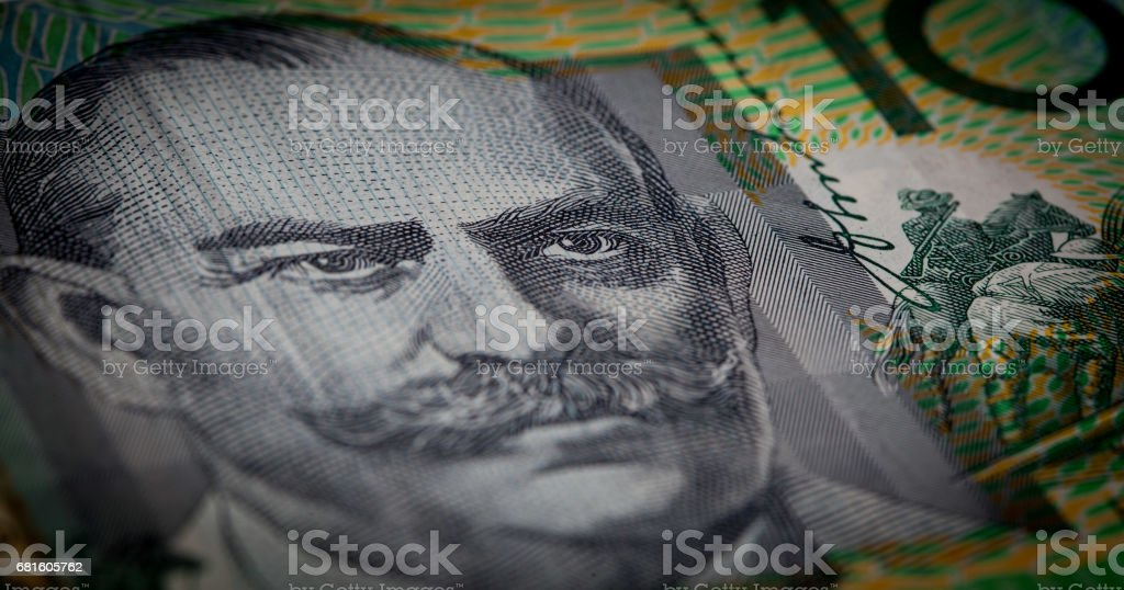 Extreme closeup of Sir John Monash portrait printed on Australia one hundred dollars banknote with shallow depth of field stock photo