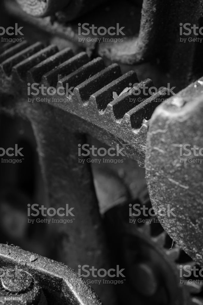 Extreme close-up of the gears, teeth and spindles in some obsolete silk manufacturing equipment stock photo