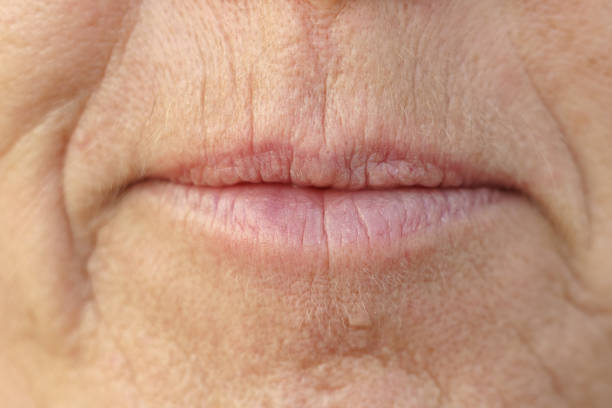 Extreme Closeup on the mouth of a middle-aged woman stock photo