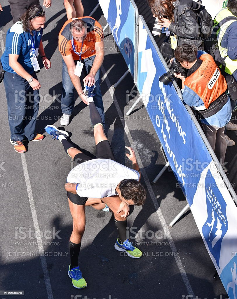 Marathon Runners in pain and dizziness exactly after crossing the...