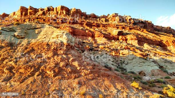 Photo of Extreme erosion below outcrops of Shinarump geological rock formation in Rockville Utah at sunset