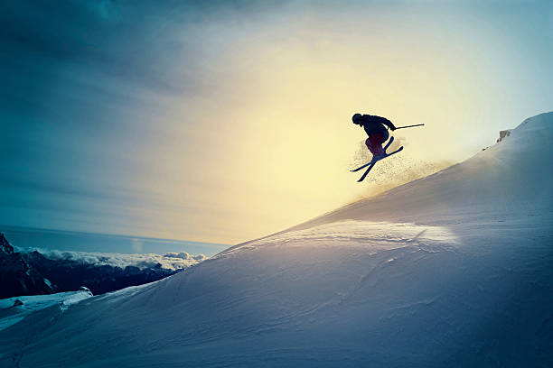 extreme   freestyle snow skier  jumping   off pist  back country skiing - daredevil stock pictures, royalty-free photos & images
