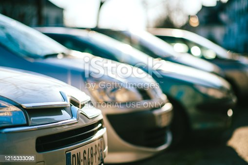 921871456 istock photo Extreme macro close-up of a Citroen logotype sign on the car front hood 1215333098