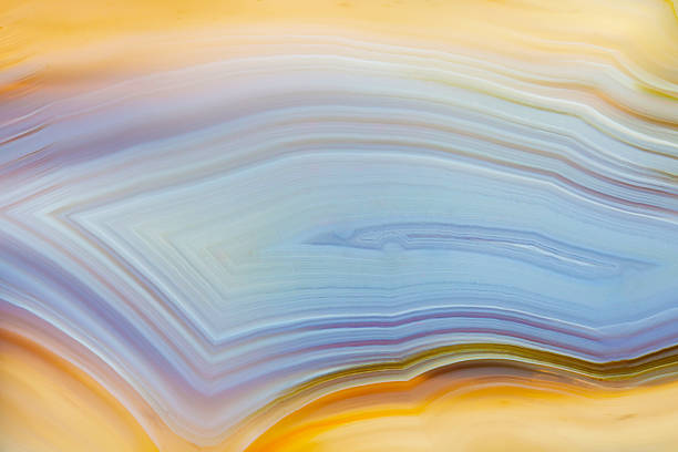 Extreme macro of blue and yellow agate mineral stock photo