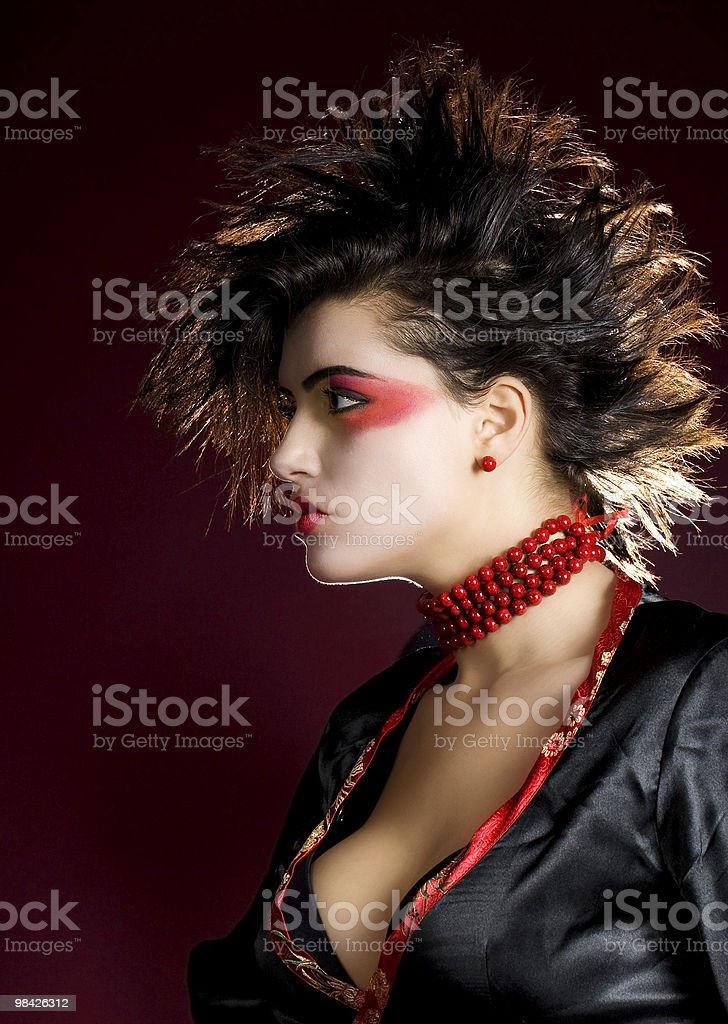 Extreme make up and hairstyle of a sexy woman royalty-free stock photo