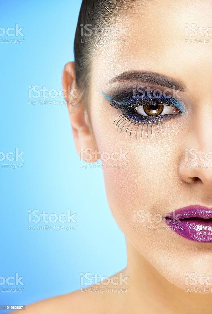 Extreme makeup. Beautiful half face stock photo