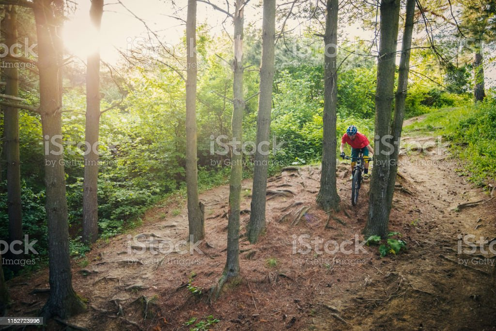 Extreme mountain biker riding over rough terrain