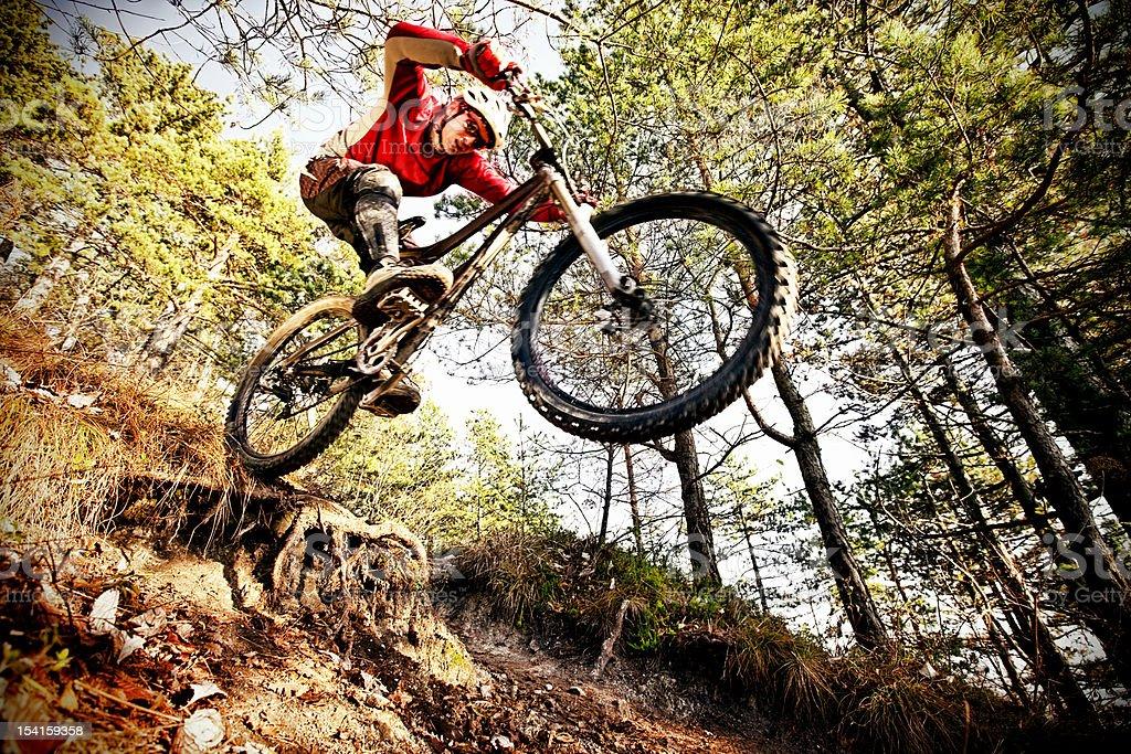 Extreme mountainbiker on steep trail stock photo